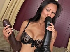 Asian Bombshell Masturbating With An Enormous Sex Toy