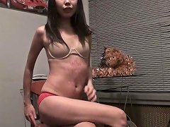 Skinny Asian Chick Fucks Shaved Pussy Sitting On The Chair